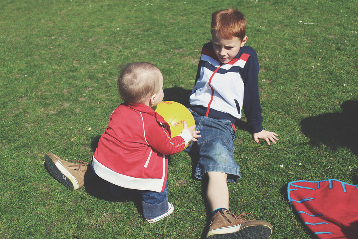 Picture Vomit - My Favourite Photos Of The Month; Toddler playing football with his big cousin at the park