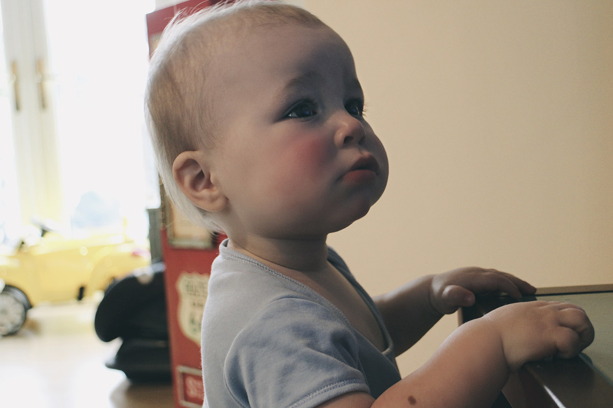 Toddler standing watching the TV