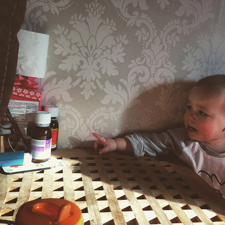 Toddler trying to reach medicine