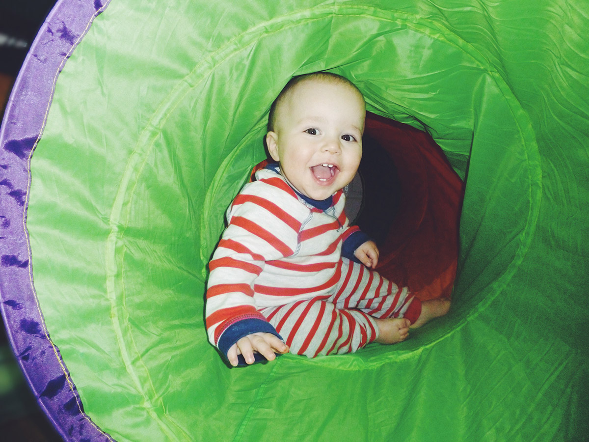 13 month old baby playing in tunnel