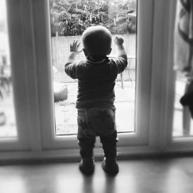 13 month old baby watching snow fall for the first time