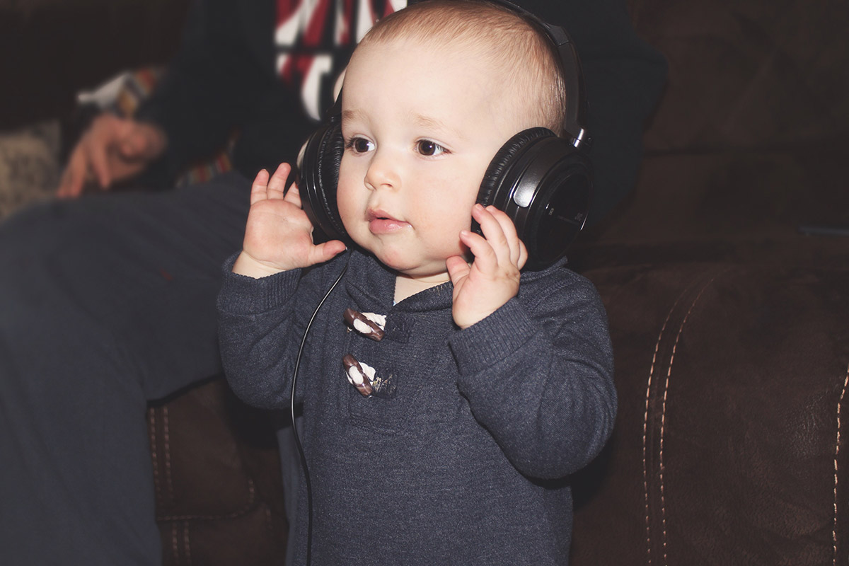 14 month old baby wearing headphones