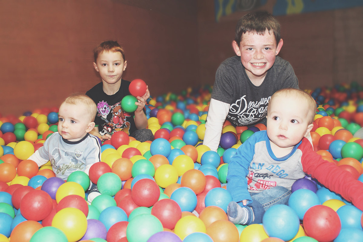 14 month old baby playing with cousins in ball pit at Roves Farm, Sevenhampton