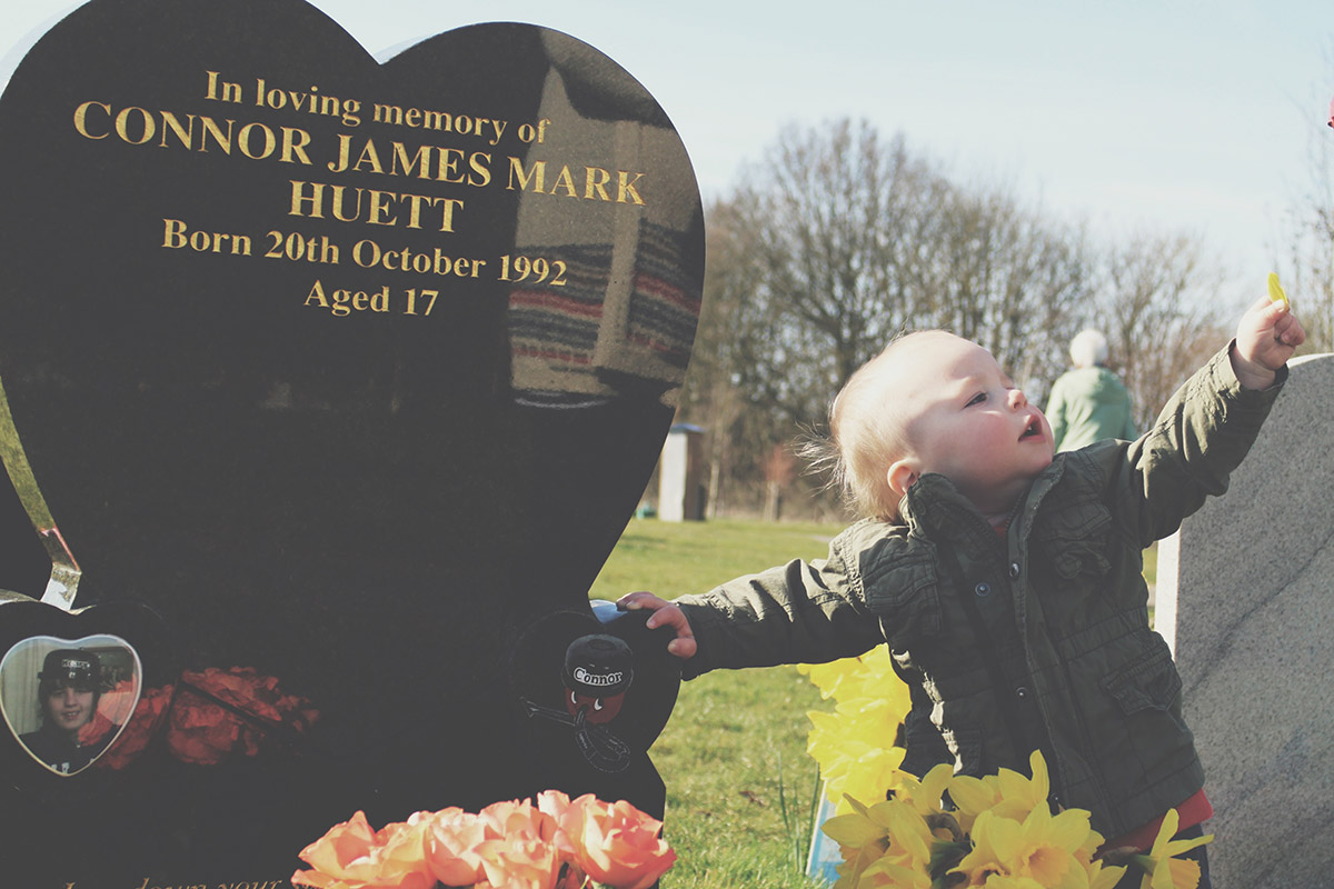 15 month old toddler visiting Uncle Connors grave at the cemetery