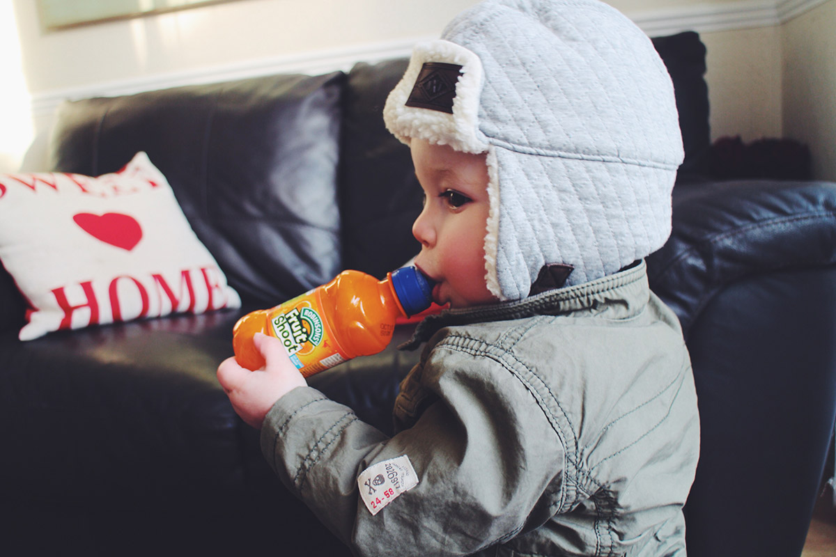 15 month old toddler drinking a fuit shoot