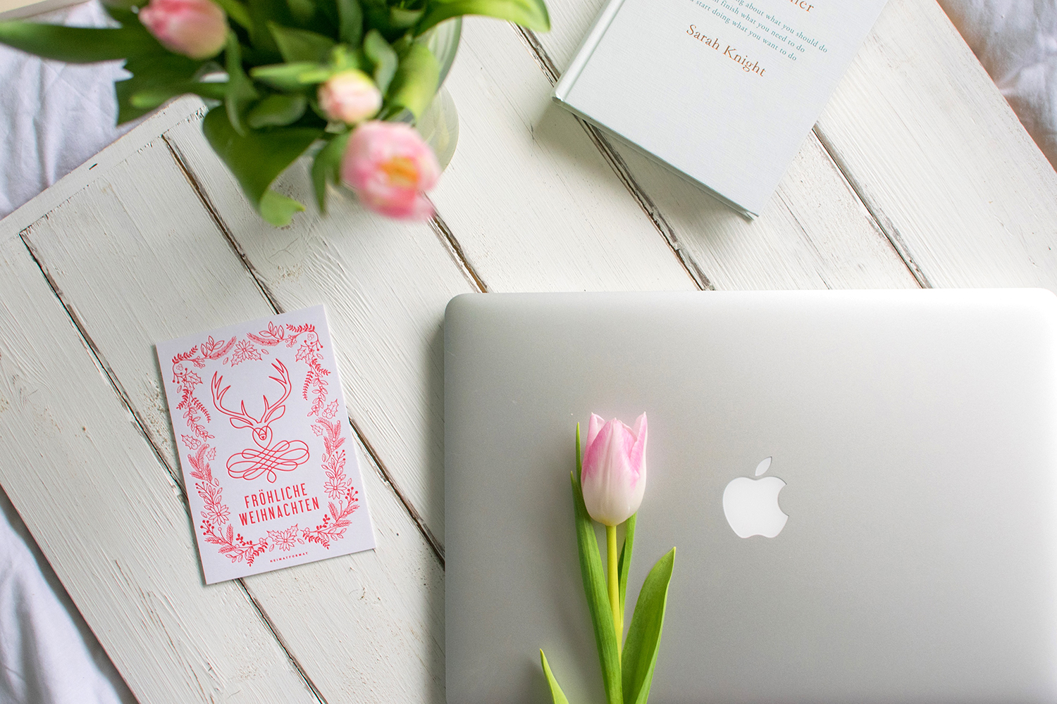 Just another 2016 recap - Flatlay on white wooden backdrop of pink tulips, icelandic designed card and get your shit together book by sarah knight, inspirational and goal-setting blog post