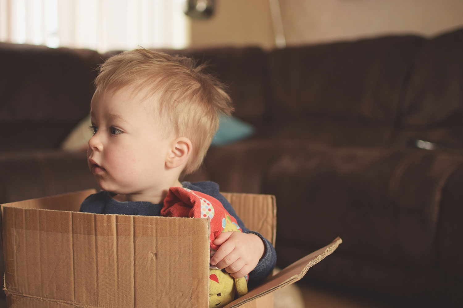 Archie's 27 Month Update - Toddler playing with cardboard box wearing Batman pyjamas