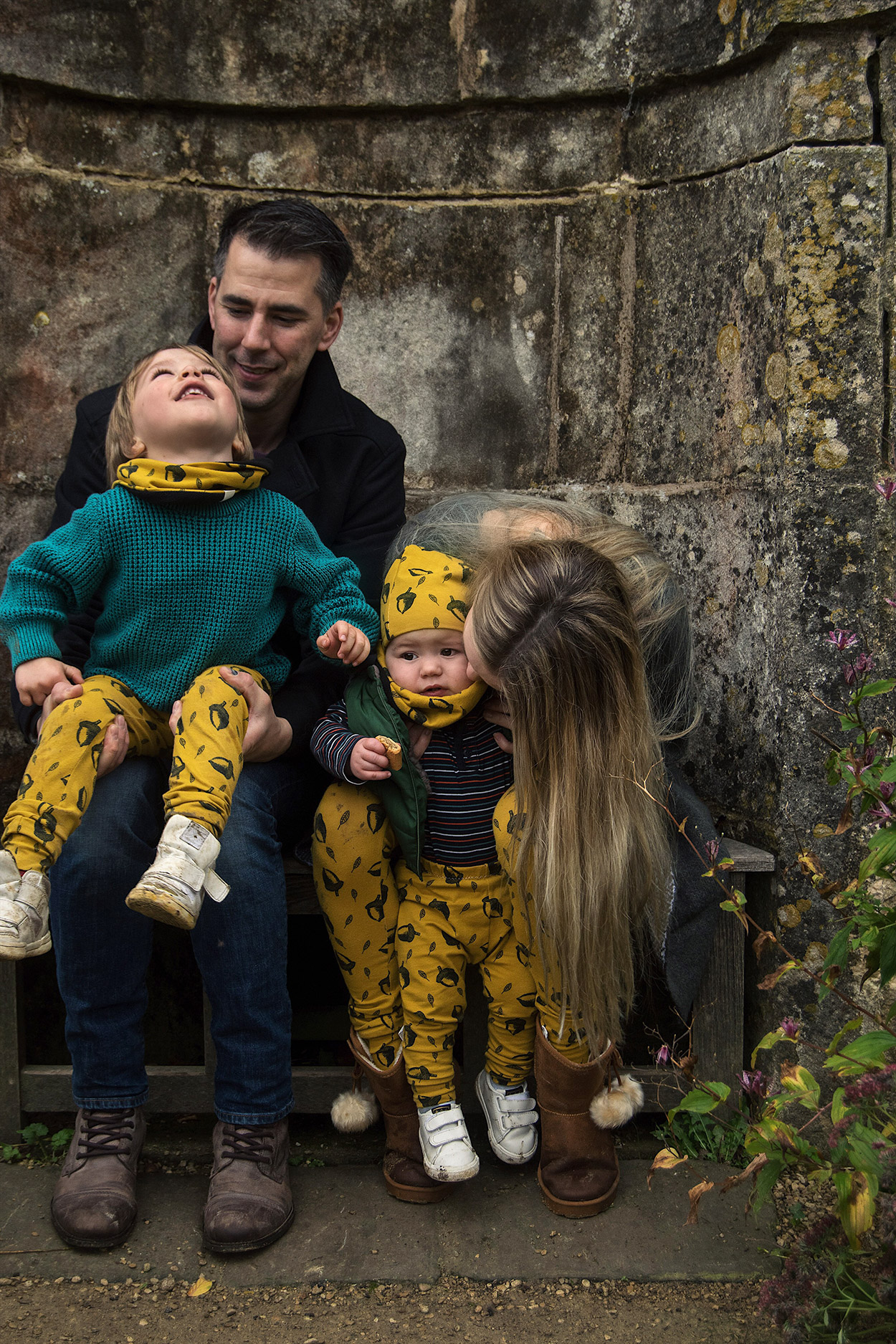 Family with two young boys visiting Dyrham Park, Bath, wearing small business Bear & Babe matching mustard acorn print on leggings, snoods and hats