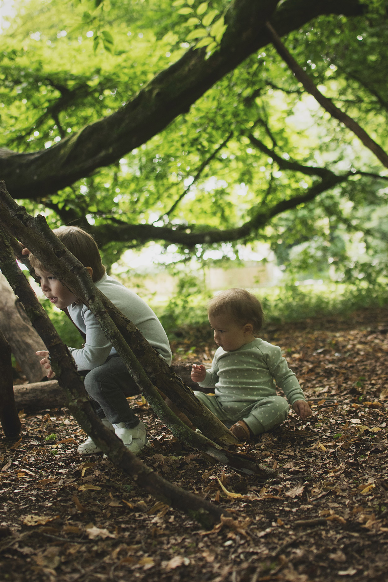 Two young boys wearing gorgeous Bob and Blossom brother sweatshirt and dotted romper and Easy Peasy slip-on leather pirate shoes whilst exploring the park in Autumn, Kid's fashion