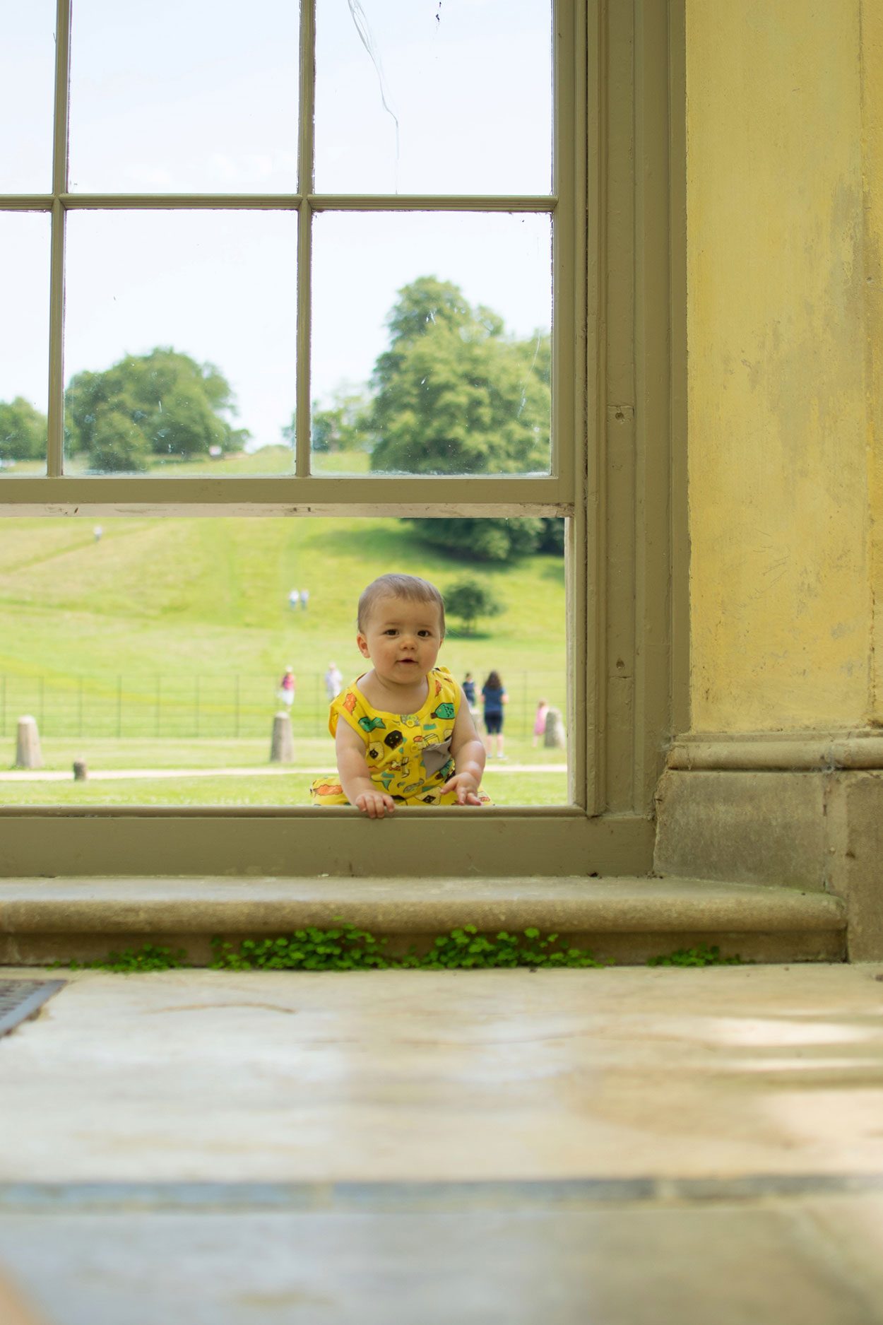 Two brothers wearing Indikidual sushi playsuits whilst exploring on a warm day at Dyrham Park near Bath during the Summer holidays