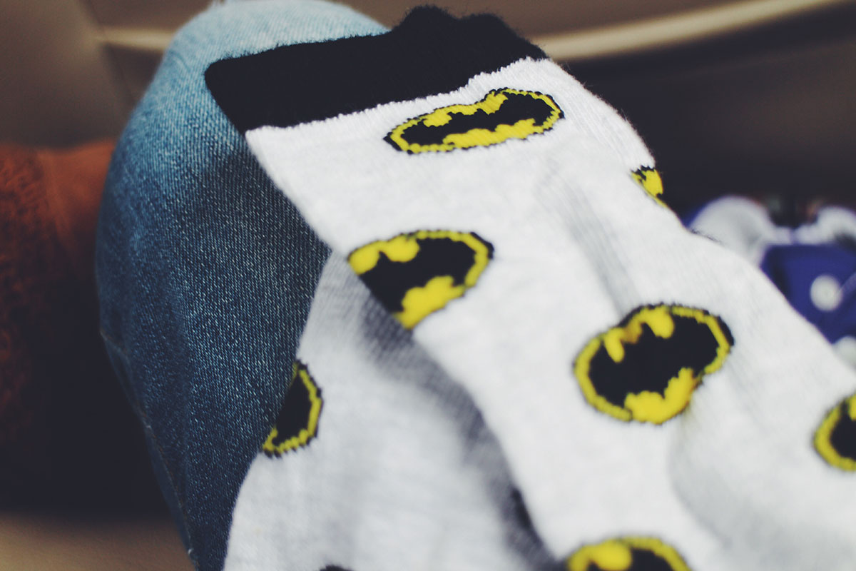 Toddler wearing H&M Batman themed socks