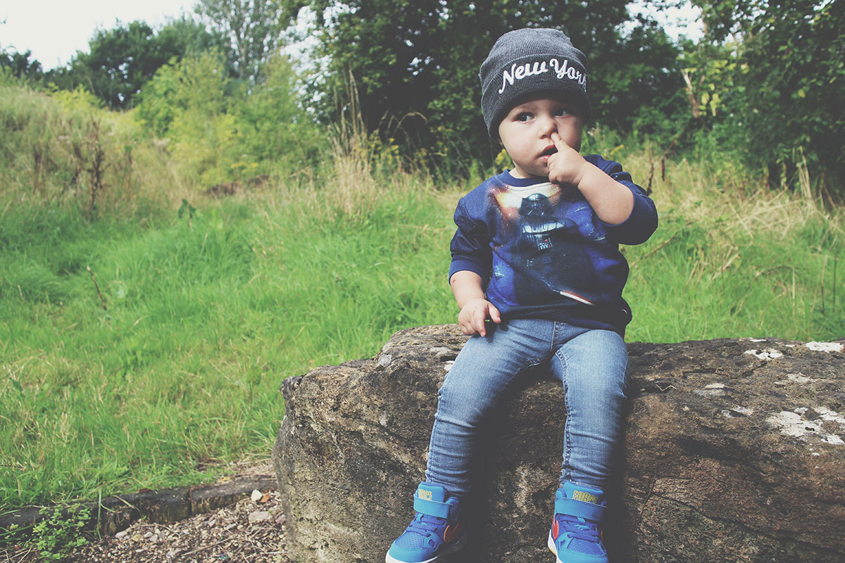 Fashion Friday; The Outtakes - Toddler wearing Star Wars jumper and New York hat posing picking his nose