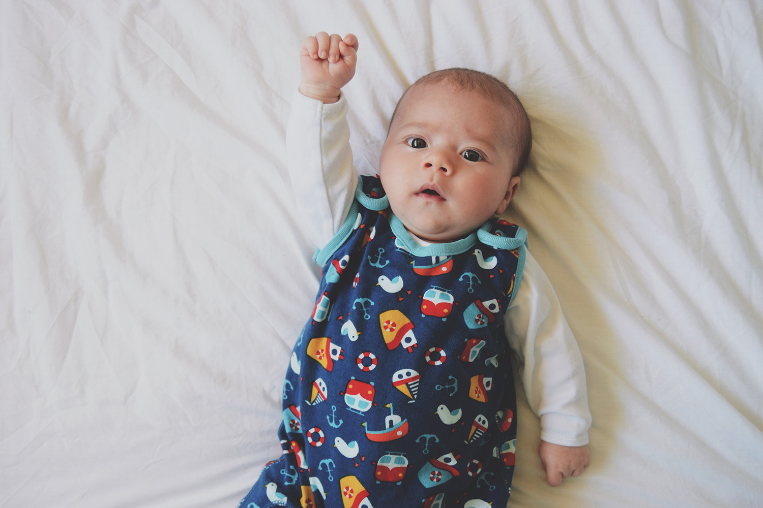 Oh, we do like to be beside the seaside {Fashion Friday 045} - Newborn baby boy wearing white vest and organic/eco-friendly Frugi seaside dungarees with arrow george lamp and lightbox