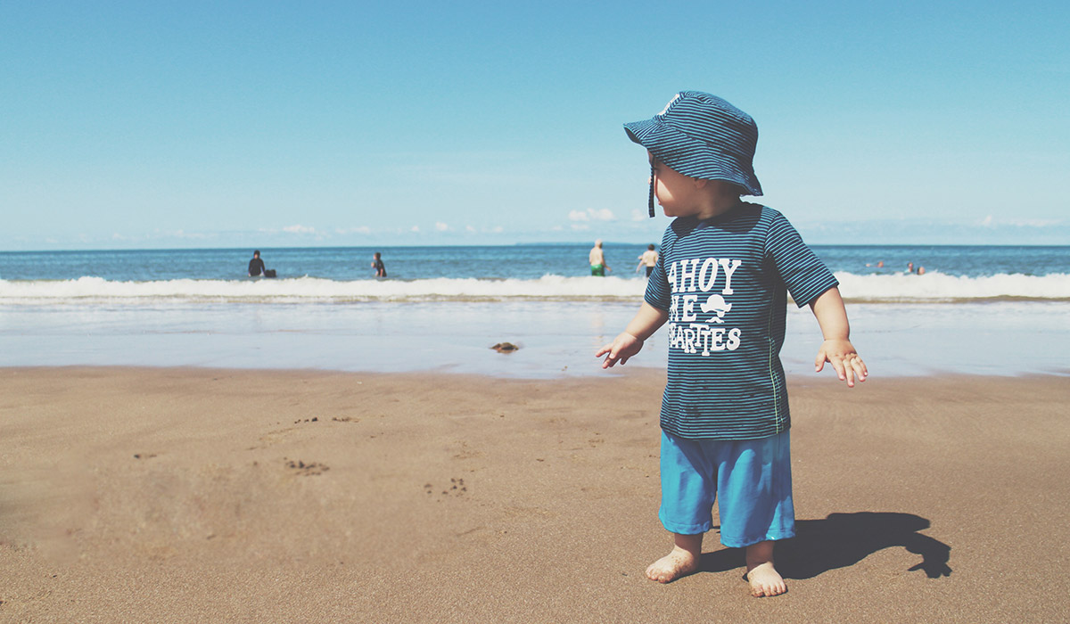 Fashion Friday; The Boys of Summer // 029 - Toddler wearing Mothercare blue stripy 'Ahoy Me Hearties' set and hat on the beach