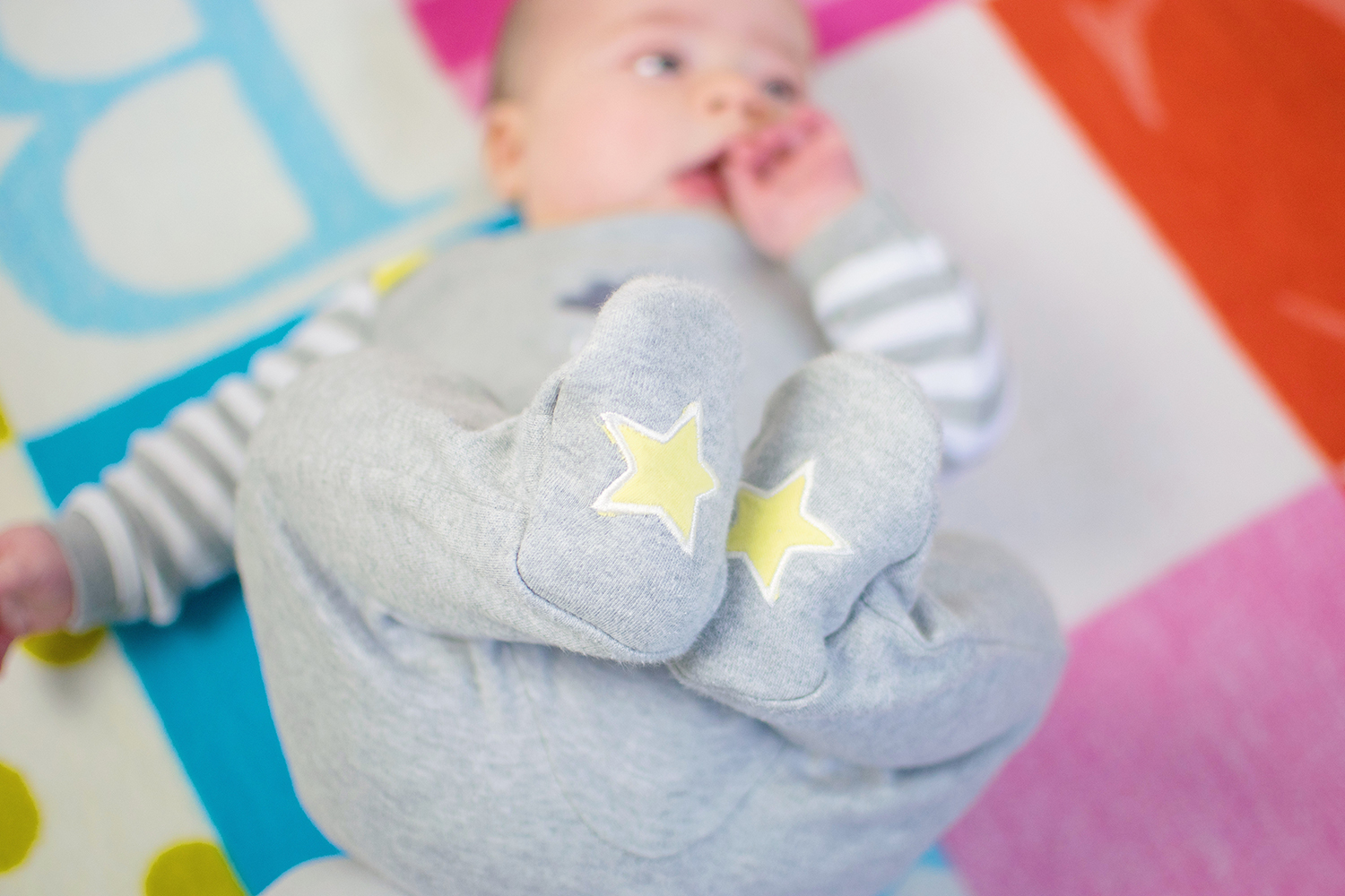 Rockin' Around the Christmas Tree {Fashion Friday 047} - Adorable 4 month old baby boy wearing Rockin' Baby grey and yellow raindrop star cloud sleepsuit on alphabet blanket
