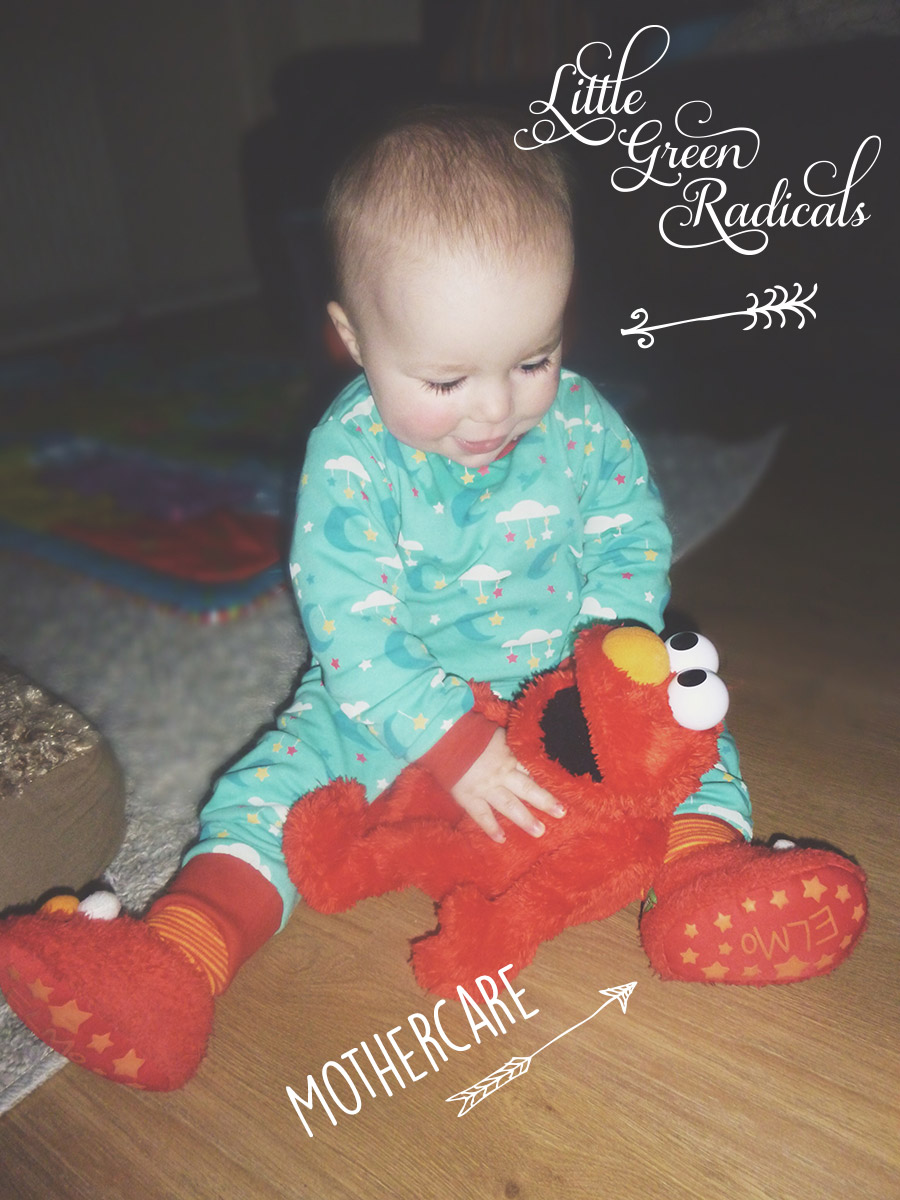 13 month old baby wearing Little Green Radicals pyjamas and Mothercare Elmo slippers
