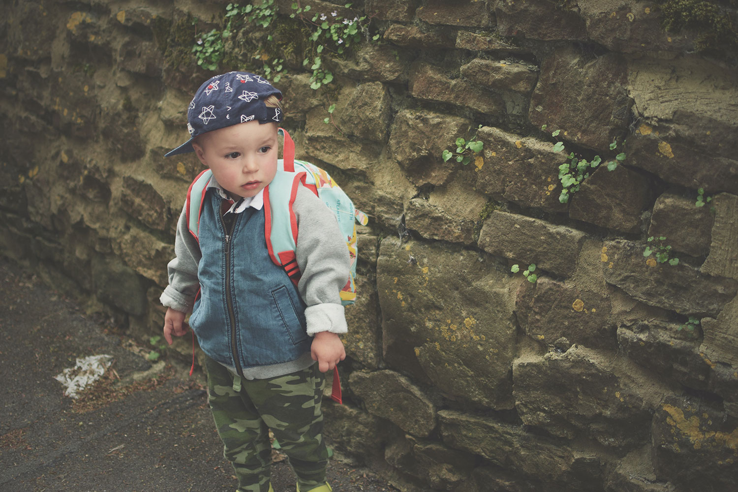 Fashion Friday; He's a Wild Adventurer // 040 - Toddler wearing Next starry baseball cap, H&M denim and sweatshirt jacket, Baby Gap camouflage leggings, green Crocs shoes and world map kids backpack