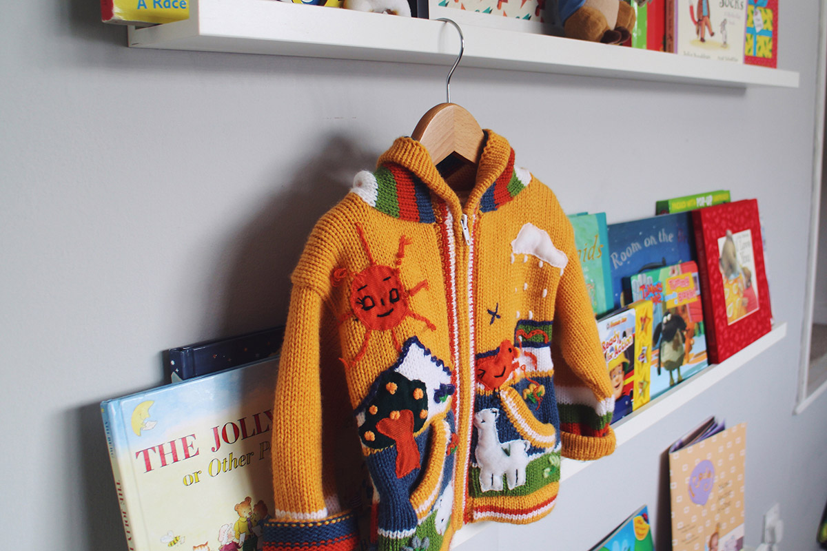 Hand-knitted and handmade in Peru, yellow cardigan from Stratford-Upon-Avon covered in landscape and animals