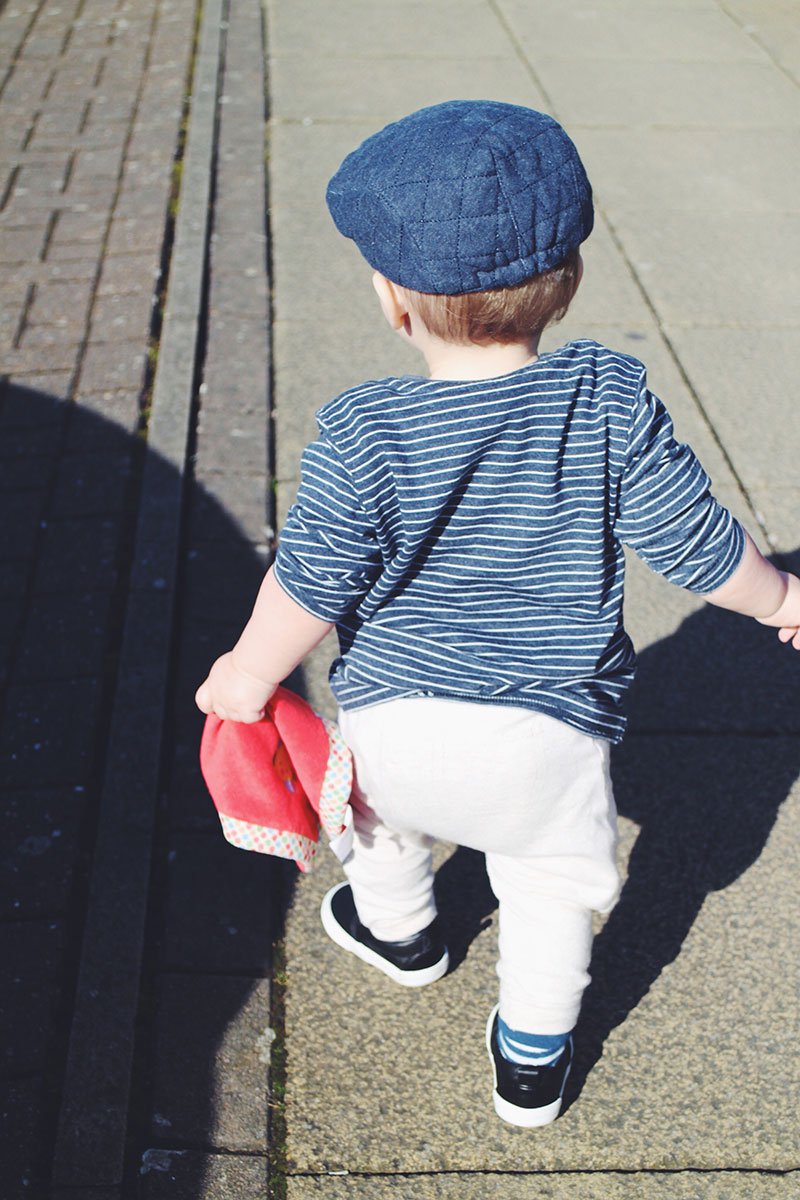 14 month old toddler wearing George outfit walking
