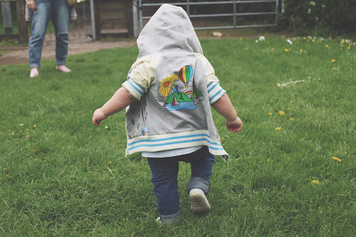 Fashion Friday #17: Toddler wearing Little Bird hoody and H&M jeans, Attipas shoes running through the park at Town Gardens