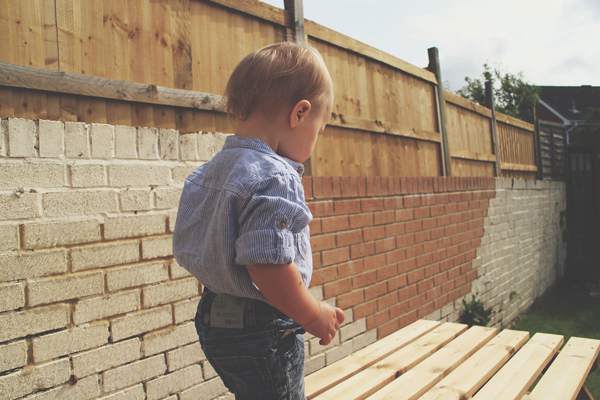Fashion Friday // 026; Be Like The Cool Kids - Toddler wearing H&M striped chambray shirt, Next denim shorts with white Converse shoes in the sun