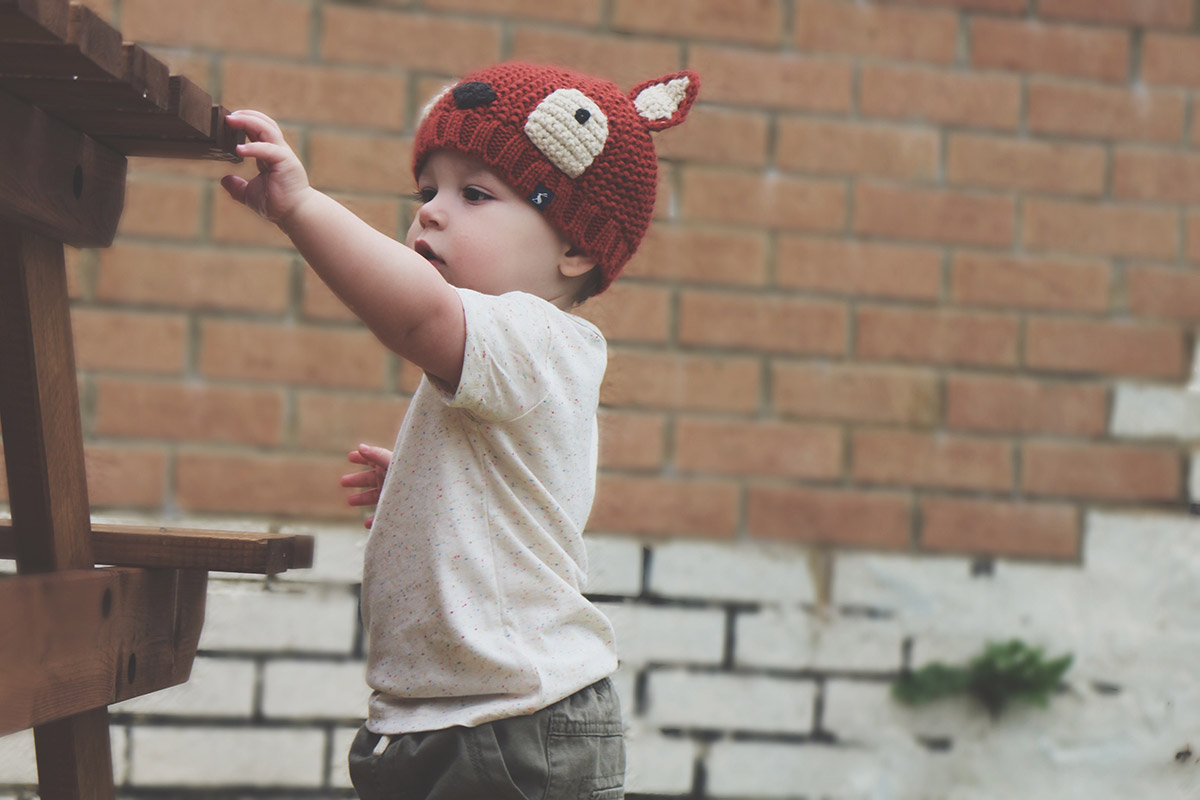 Fashion Friday // 019; Toddler wearing Joules fox hat, Next cream speckled t-shirt and Next green trousers
