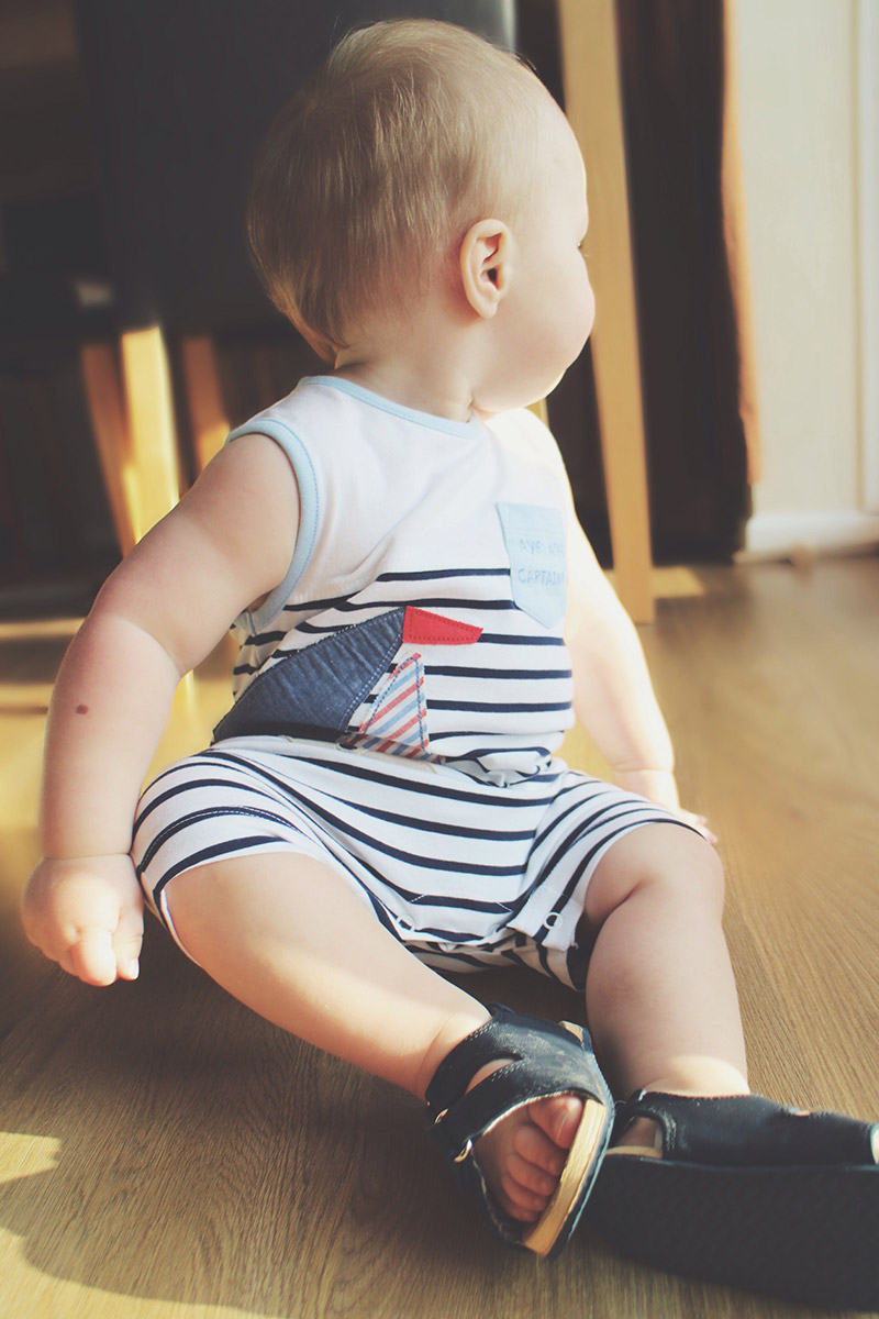 Toddler wearing Next nautical romper & sandals