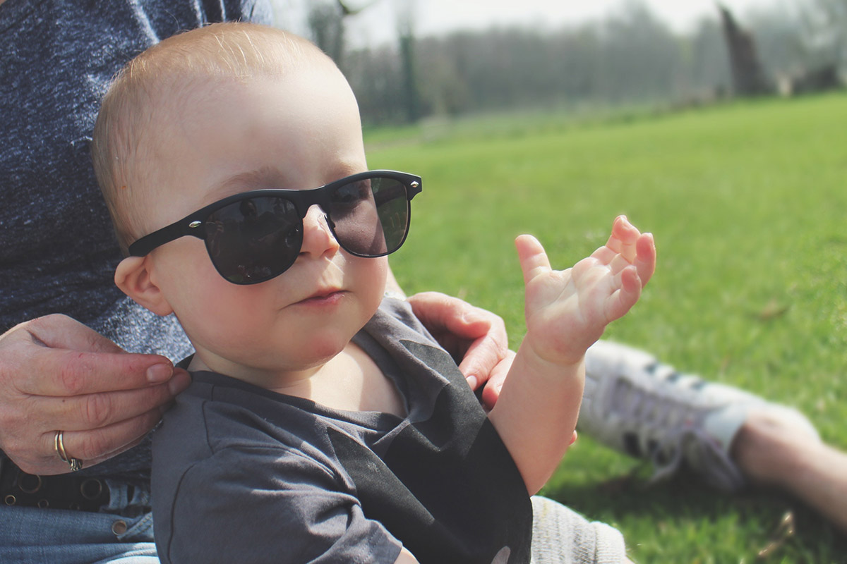 Toddler at the park wearing River Island sunglasses