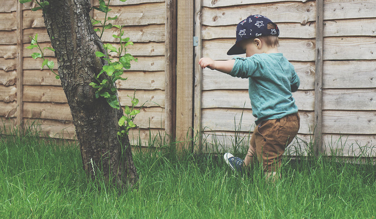 Fashion Friday // Toddler wearing Next shorts, baseball cap and shoes, H&M tee playing in the garden