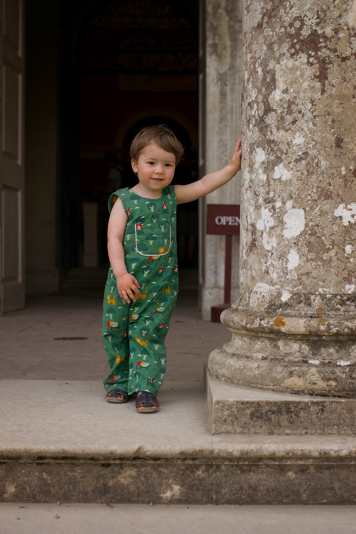 Two brothers wearing Little Green Radicals, organic clothing brand, Wanderlust, Jungle Adventures Dungarees, visiting Stourhead National Trust for Easter with Mum and grandparents