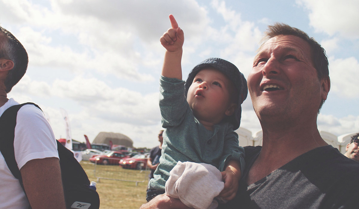 Toddlers' Day Out @ RAF Fairford Air Tattoo - Toddler with Grandad looking up at the planes in the sky