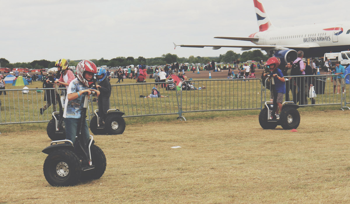 Toddlers' Day Out @ RAF Fairford Air Tattoo - Child riding a segway, just one of the activities at the Fairford Air Tattoo