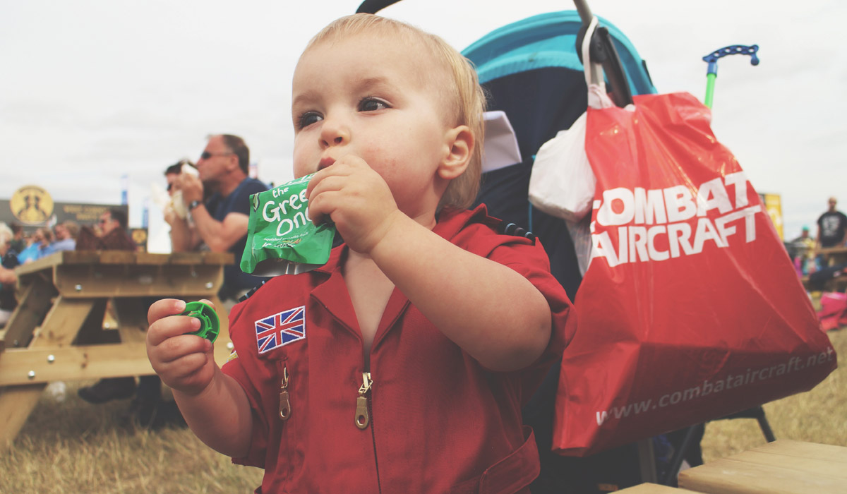 Toddlers' Day Out @ RAF Fairford Air Tattoo - Toddler wearing Red Arrow boiler suit at the Air Tattoo, having a fun day out