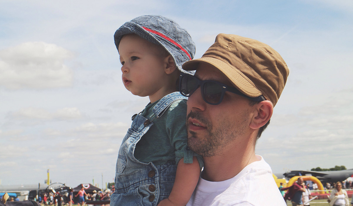 Toddlers' Day Out @ RAF Fairford Air Tattoo - Son with Daddy watching BMX show at the Air Tattoo