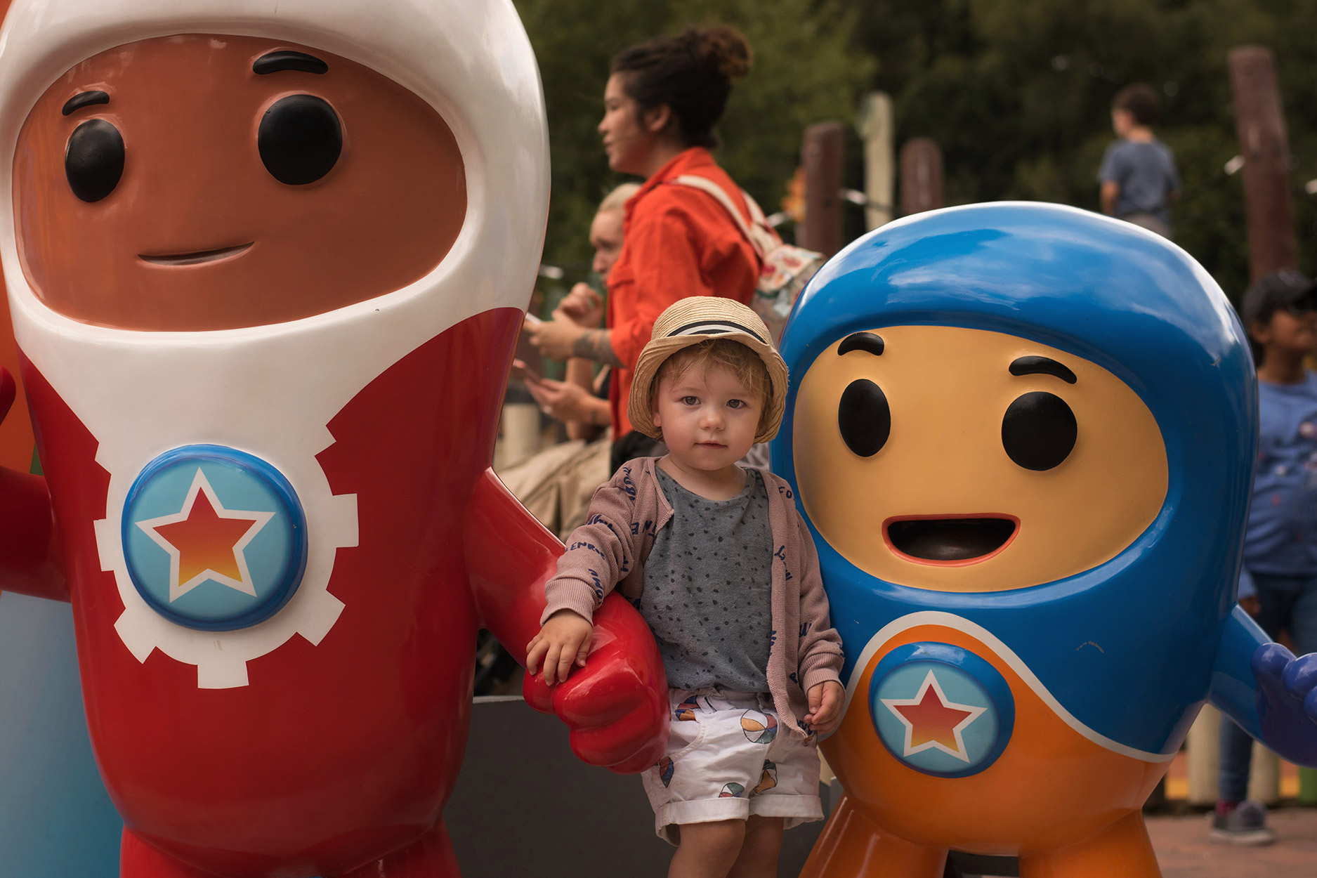 Toddler wearing Bobo Choses and Maed for Mini posing with the Go-Jetters in CBeebies Land, Alton Towers, Stoke-on-Trent