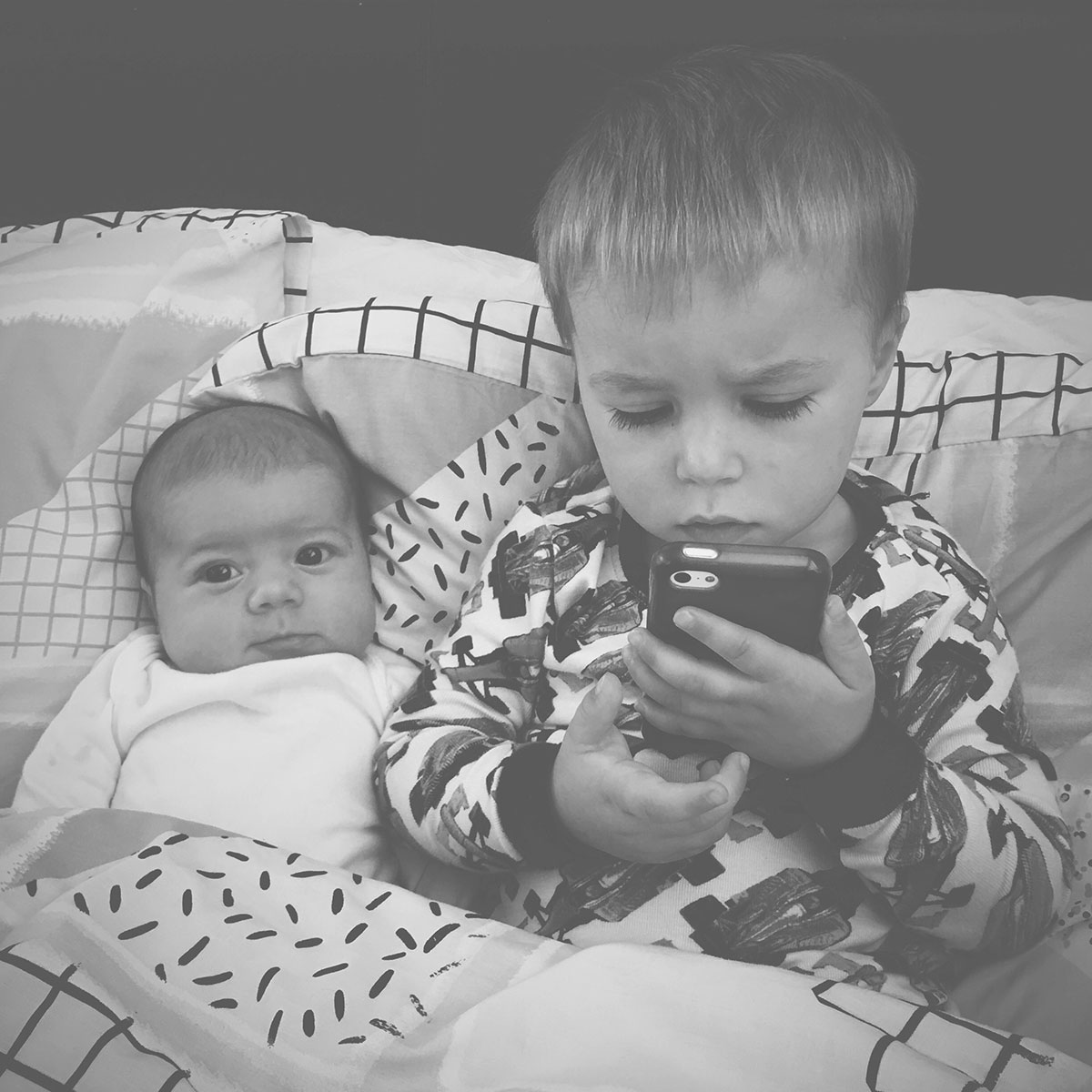 Baby Jesse Blue at 2 months old - Newborn in bed with his big brother having cuddles, watching youtube