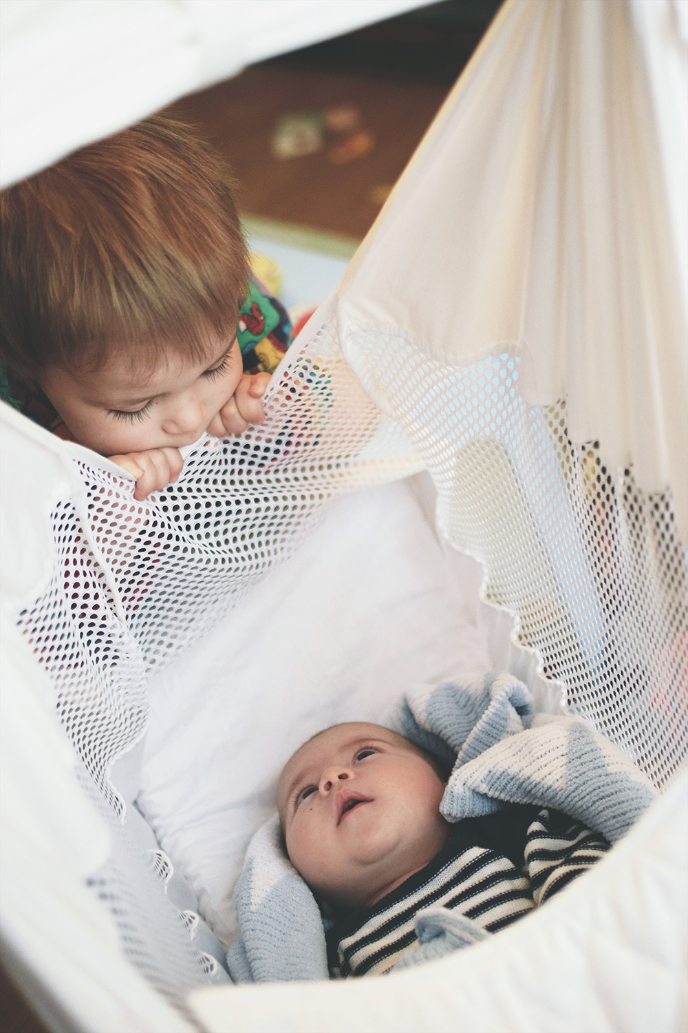 Baby Jesse Blue at 4 months old - Newborn baby boy in his Poco Baby Hammock looking up at older toddler brother