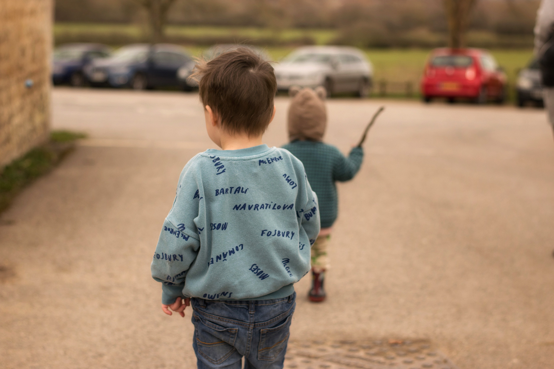 Two young brothers at the park with Nanny and Mummy wearing Bobo Choses Legends dusky pink cardigan and blue sweatshirt, American Apparel green t-shirt, MyK by Myleene Klass Mickey hats, Lamb & Bear crocs leggings and Joules wellies