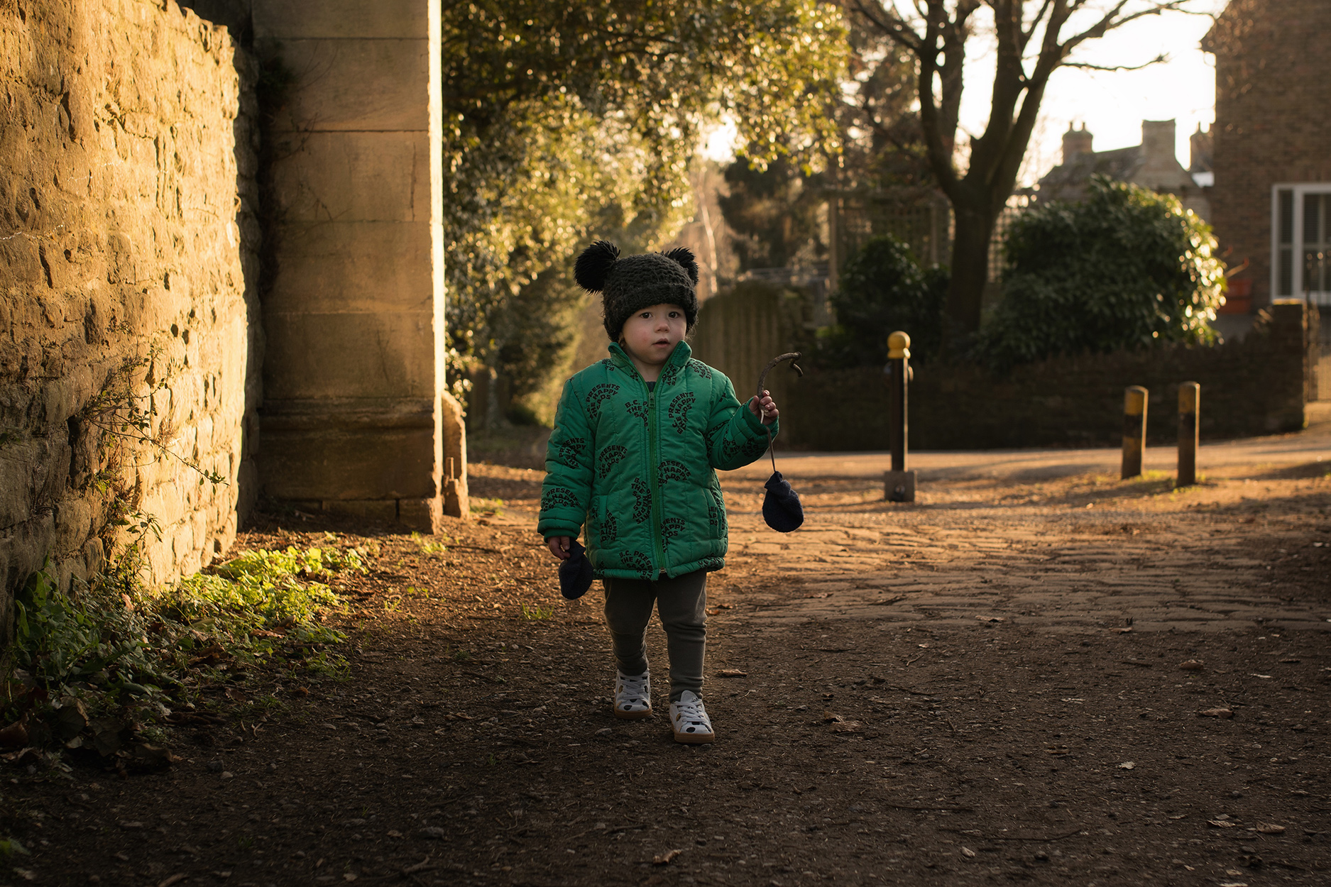 Family walk around woodlands, boys wearing Bobo Choses The Happy Sads collection, Puma x Tiny Cottons spotty shoes, MyK black knitted hats and Rylee and Cru faux fur coat