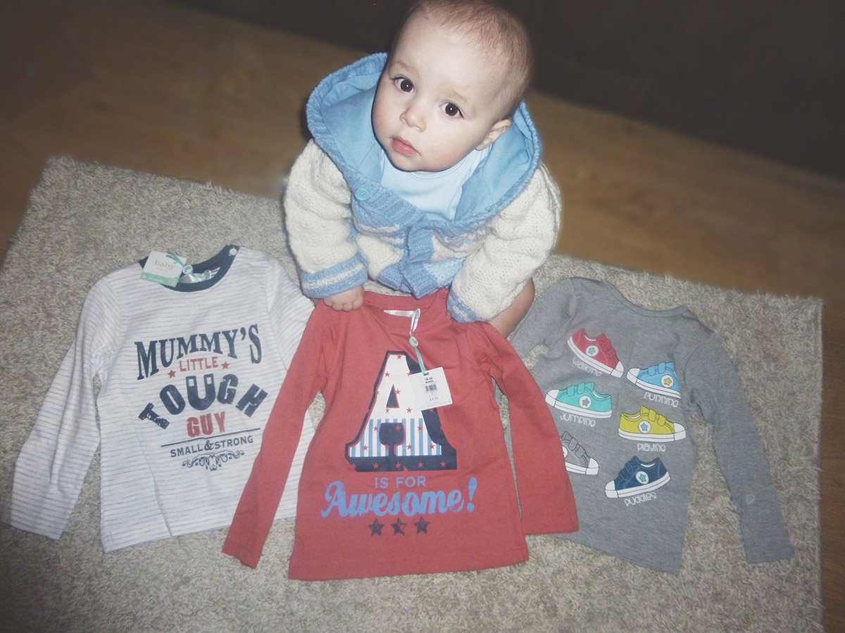 13 month old baby with shirts received as a gift
