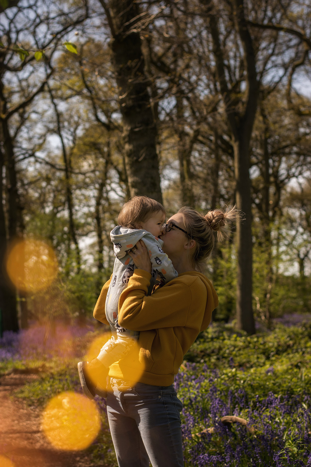Mum and toddler son wearing Filemon Kid together amongst the lavender of Hagbourne Copse, Wiltshire