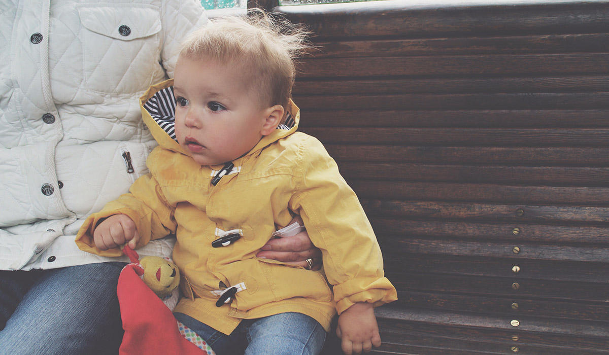 Our Devon Holiday 2015 - Toddler wearing yellow rain mac on Lynton & Lynmouth cliffside railway