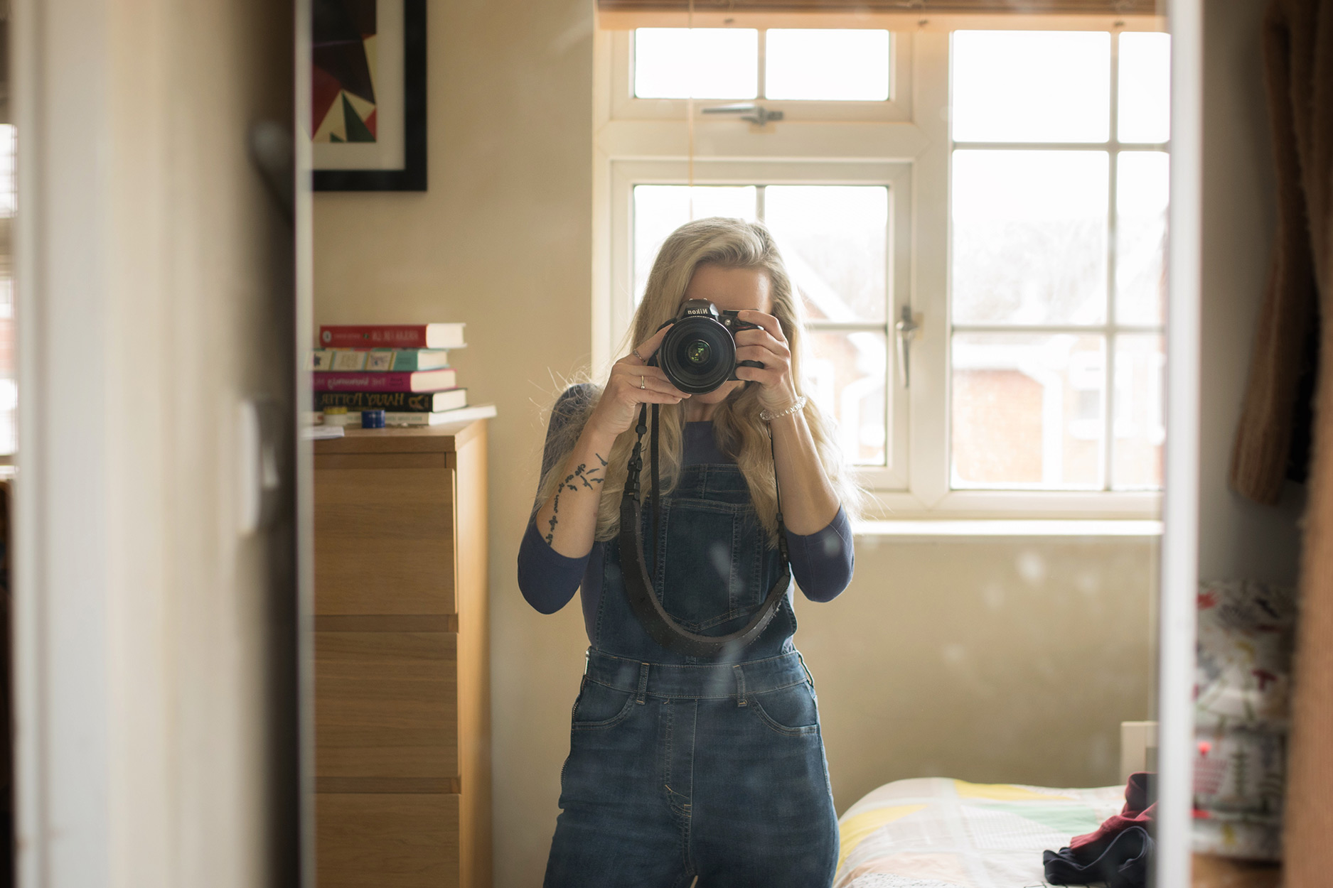 Mum wearing denim H&M dungarees taking a selfie, candid photography taken on Nikon D3300