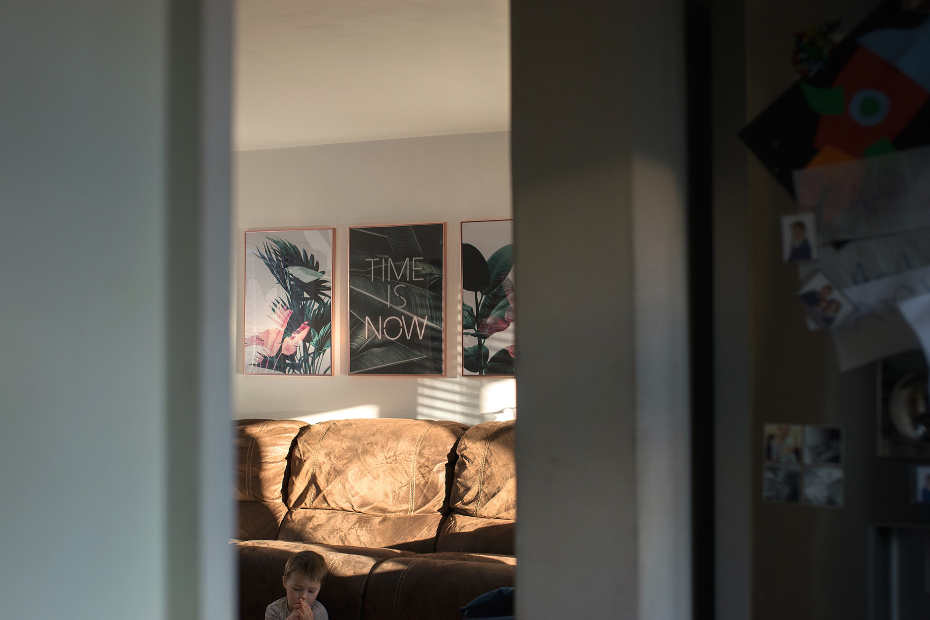 Candid family day in the life photoshoot   Recently renovated living room featuring Desenio plant wall art prints