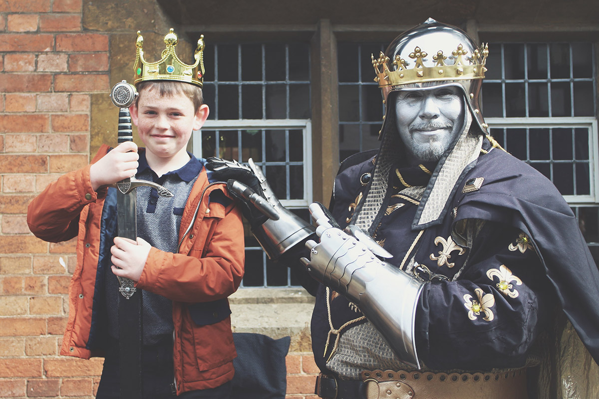 An Easter Weekend Catch-Up - Young boy holding sword and wearing crown next to knight at Stratford-Upon-Avon