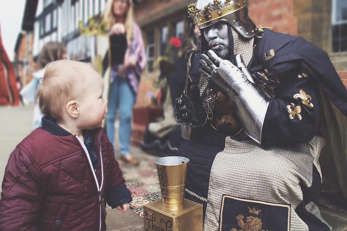 An Easter Weekend Catch-Up - Toddler staring at knight blowing kiss at Stratford-Upon-Avon