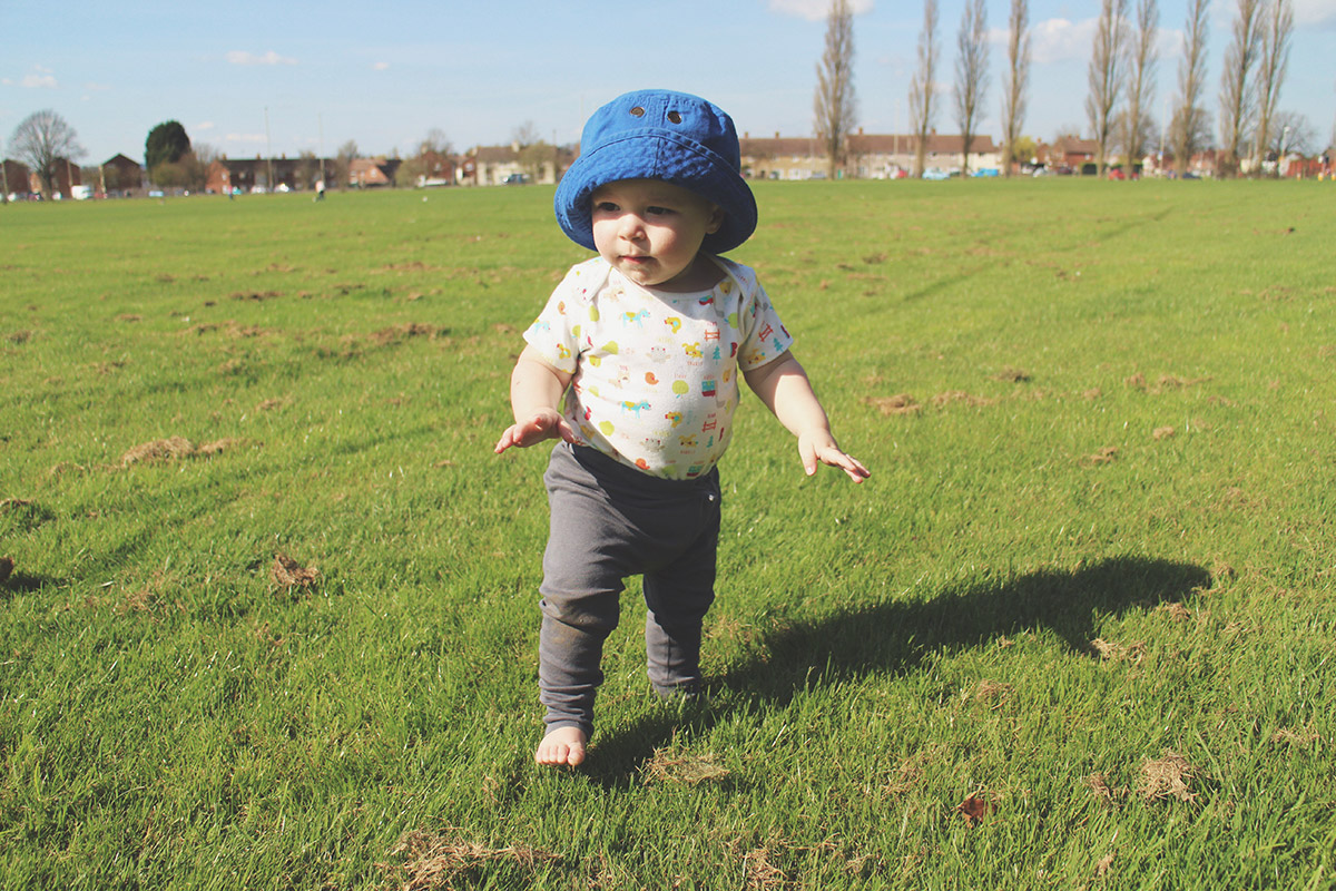 An Easter Weekend Catch-Up - Toddler running across field at family BQ wearing sunhat