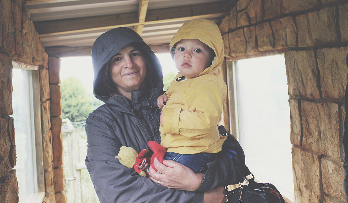Toddlers' Day Out @ Exmoor Zoo, North Devon - Toddler wearing raincoat with Nanny