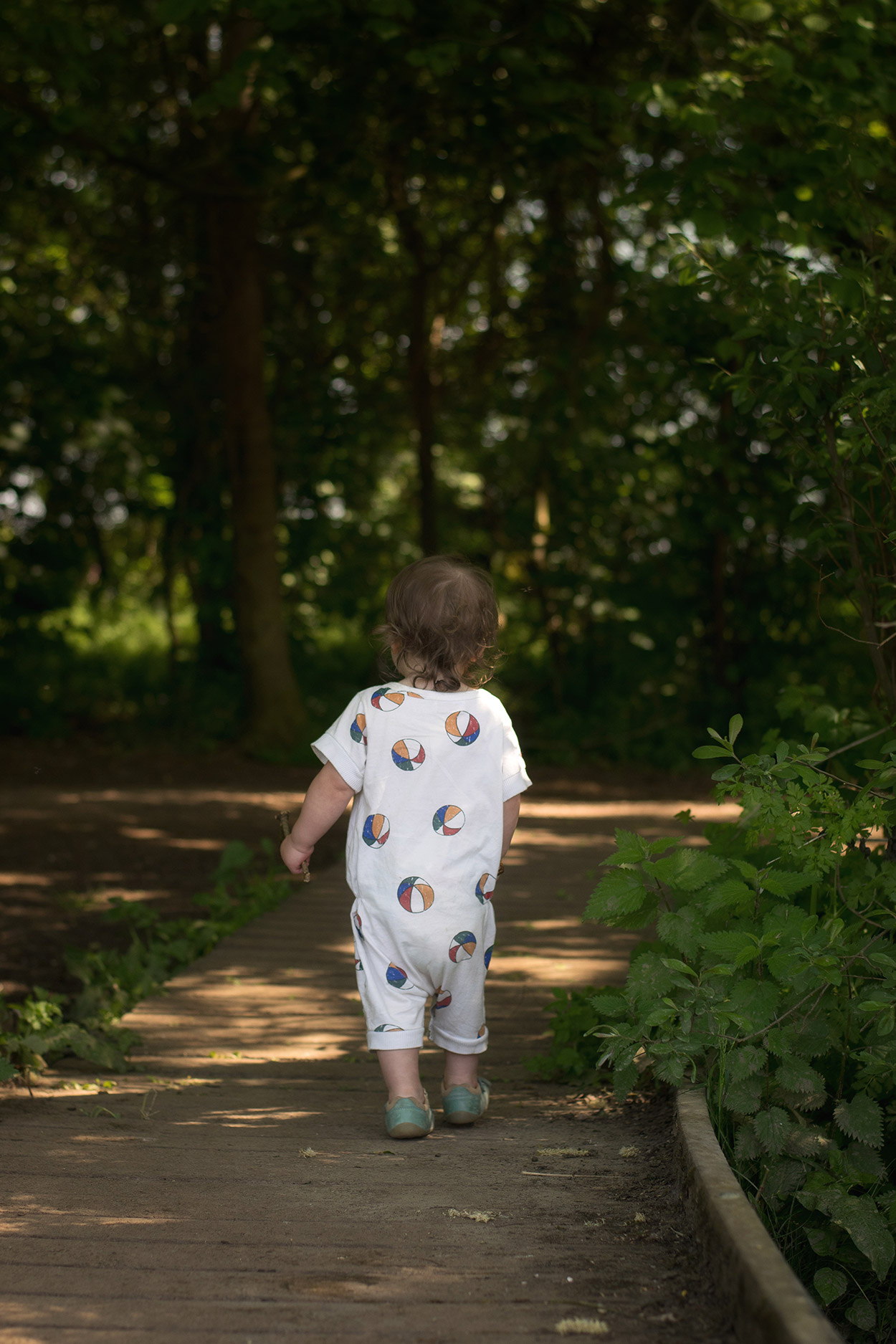 Two boys and grandparents on a Summery outdoor walk wearing vintage Bobo Choses and Bobux shoes