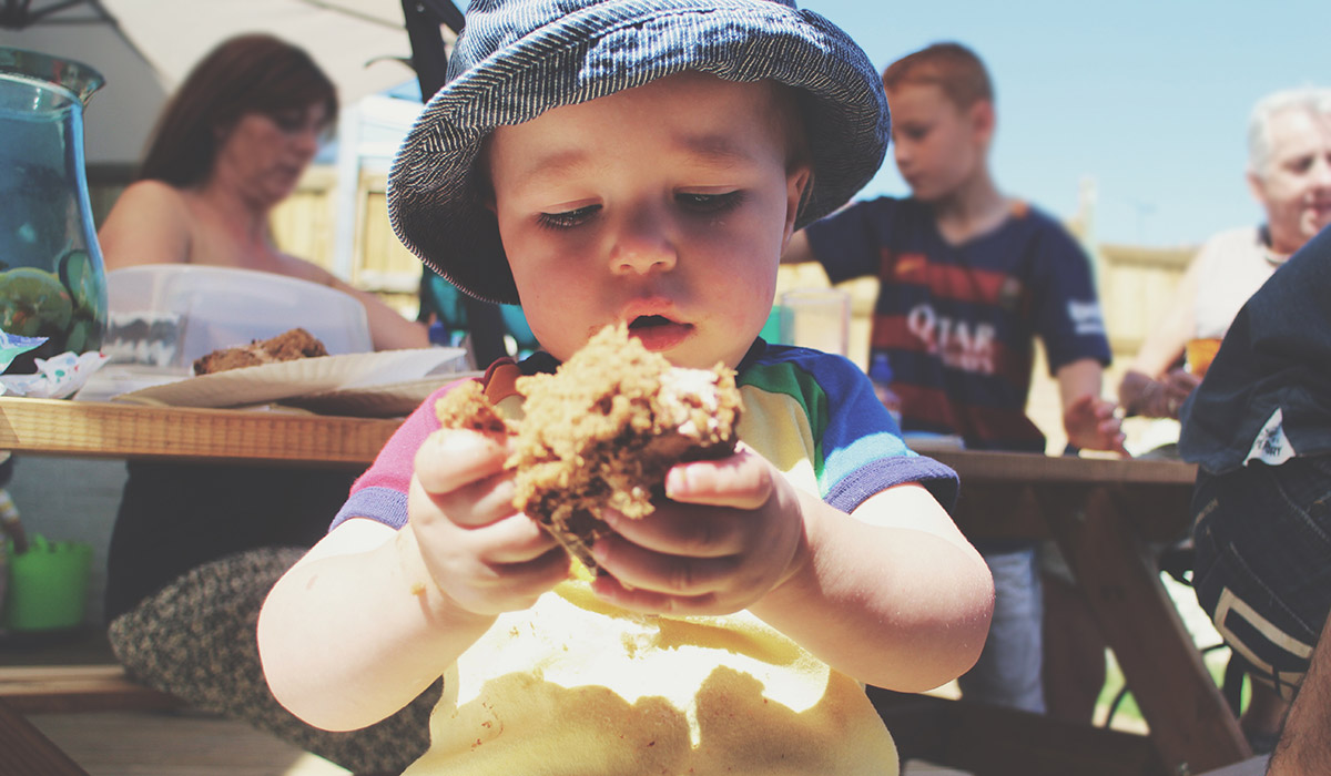 5 Steps to Pulling Off a Successful British BBQ - Toddler stuffing his face with chocolate birthday sponge cake
